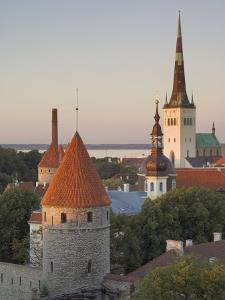 Medieval Town Walls and Spire of St. Olav's Church at Dusk, Tallinn, Estonia, Baltic States by Neale Clarke