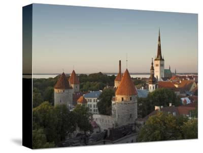 Medieval Town Walls and Spire of St. Olavs Church at Dusk, Tallinn, Estonia, Baltic States, Europe