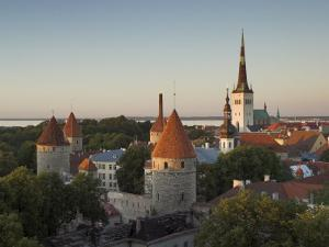 Medieval Town Walls and Spire of St. Olavs Church at Dusk, Tallinn, Estonia, Baltic States, Europe by Neale Clarke