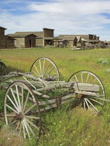 Old Western Wagons from the Pioneering Days of the Wild West at Cody, Montana, USA by Neale Clarke