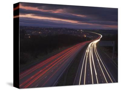 Traffic Light Trails in the Evening on the M1 Motorway Near Junction 28, Derbyshire, England, UK