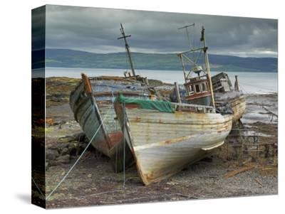 Wrecked Fishing Boats in Gathering Storm, Salen, Isle of Mull, Inner Hebrides, Scotland, UK
