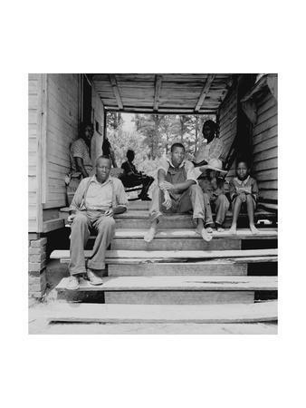 https://imgc.artprintimages.com/img/print/negro-family-sharecroppers-on-porch_u-l-pgjqj70.jpg?p=0