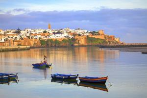 Harbour and Fishing Boats with Oudaia Kasbah and Coastline in Background, Rabat, Morocco by Neil Farrin