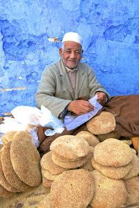 Vendor with Freshly Baked Bread, Rabat, Morocco, North Africa by Neil Farrin