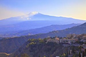 View from Greek Theatre to Taormina with Mount Etna in Background, Taormina, Sicily, Italy, Europe by Neil Farrin