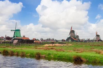 Dutch Windmills over River