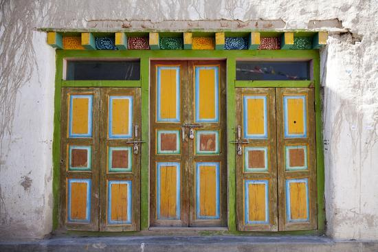 Nepal, Mustang, Lo Manthang. Brightly Painted Doors in the Ancient Capital of Lo Manthang.-Katie Garrod-Photographic Print