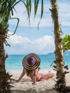 Woman Relaxing on the Beach in Thailand by Netfalls