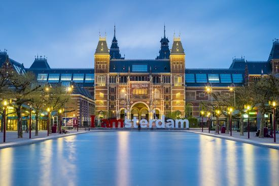 Netherlands, North Holland, Amsterdam. The Rijksmuseum on Museumplein at dusk.-Jason Langley-Photographic Print