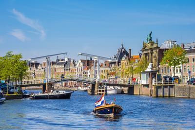 https://imgc.artprintimages.com/img/print/netherlands-north-holland-haarlem-a-boat-in-front-of-the-gravestenenbrug-drawbridge-on-the-spaar_u-l-q1bpw130.jpg?p=0