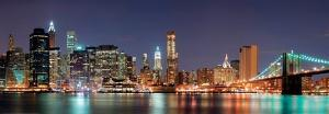 New York City - Manhattan Skyline Panorama with Brooklyn Bridge at Night