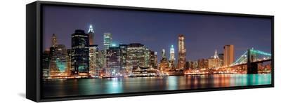 New York City - Manhattan Skyline Panorama with Brooklyn Bridge at Night--Framed Canvas Print