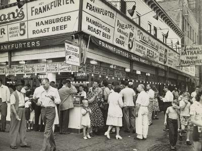 New York City Street Corner with Customers Ordering and Eating Nathan's Hot Dogs--Photo