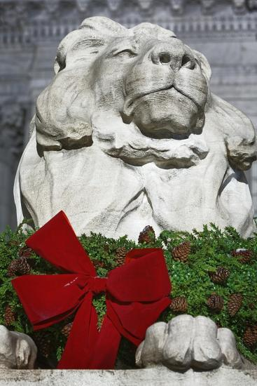 New York Public Library Lion Decorated with a Christmas Wreath during the Holidays.-Jon Hicks-Photographic Print