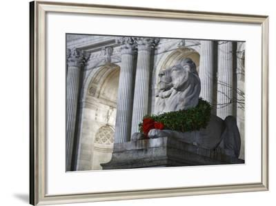 New York Public Library Lion Decorated with a Christmas Wreath during the Holidays.-Jon Hicks-Framed Photographic Print