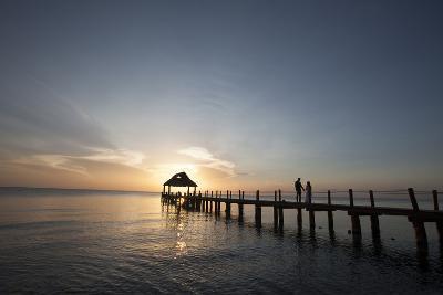 Newlyweds Walk Along a Pier on the West Coast of Cozumel Island-Michael and Jennifer Lewis-Photographic Print
