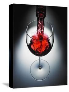 Wine poured in glass by Newmann