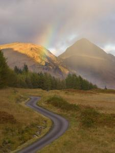 Mountain Road with Rainbow in Glen Etive, Argyll, Scotland, UK, October 2007 by Niall Benvie