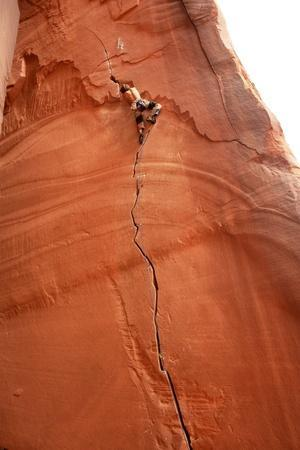 A Climber On An Overhanging Route In Indian Creek, Utah