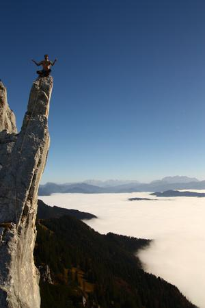 A Climber On Top Of A Rock Formation Meditating