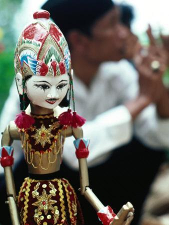 Traditional Puppet with Vendor in Background, Jakarta, Indonesia