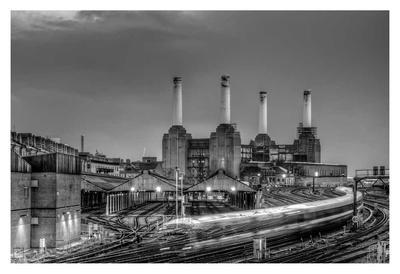 Trains pass Battersea Power Sation