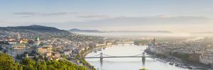 Hungary, Central Hungary, Budapest. Sunrise over Budapest and the Danube from Gellert Hill. by Nick Ledger