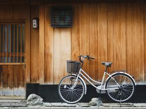 Japan, Chubu Region, Kyoto, Gion, a Bicycle Rests Against the Wall of a Traditional Building by Nick Ledger