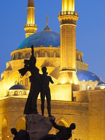 Lebanon, Beirut, Statue in Martyr's Square and Mohammed Al-Amin Mosque at Dusk