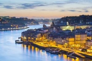 Portugal, Douro Litoral, Porto. Dusk in the UNESCO listed Ribeira district, viewed from Dom Luis I  by Nick Ledger