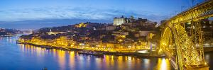 Portugal, Douro Litoral, Porto. Dusk in the UNESCO listed Ribeira district. by Nick Ledger