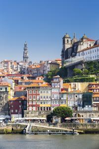 Portugal, Douro Litoral, Porto. The view across the Douro River to the UNESCO listed Old Town of Po by Nick Ledger