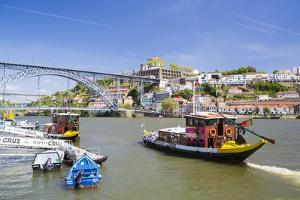 Portugal, Douro Litoral, Porto. Tourists boats on Douro River in the UNESCO listed Ribeira district by Nick Ledger