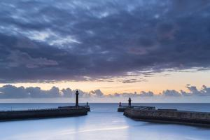 United Kingdom, England, North Yorkshire, Whitby. the Piers at Dusk. by Nick Ledger