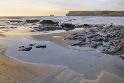 Tide Retreating at Sunset Leaving Tide Pools Among Rocks