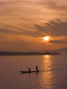 Fishermen at Sunset on the Amazon River, Brazil, South America by Nico Tondini