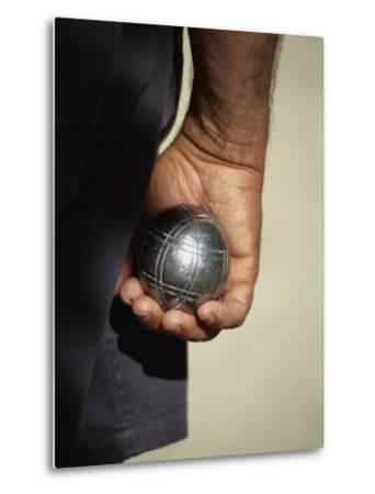 Bocce Bowler Holding a Ball
