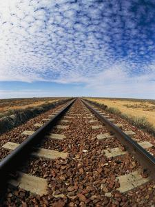 Clouds Hover over Old Railroad Tracks by Nicole Duplaix