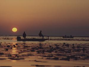 Fishermen Take in the First Rays of the Rising Sun on Lake Okeechobee by Nicole Duplaix