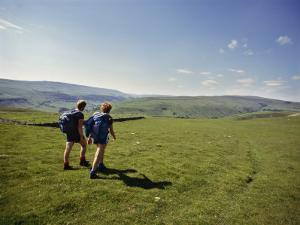Couple Walking on the Dalesway Long Distance Footpath, Near Kettlewell, Yorkshire by Nigel Blythe