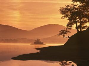 Mist Rising on Derwent Water at Dawn, Lake District National Park, Cumbria, England, United Kingdom by Nigel Blythe