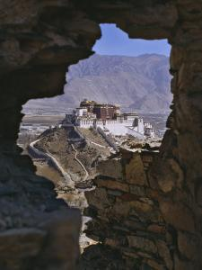 Potala Palace, Seen Through Ruined Fort Window, Lhasa, Tibet by Nigel Blythe