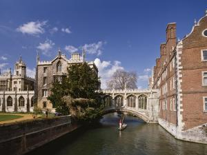 Punting under the Bridge of Sighs, River Cam at St. John's College, Cambridge, England by Nigel Blythe