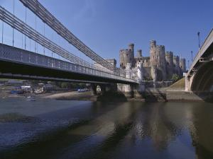 Telford Suspension Bridge, Opened in 1826, Crossing the River Conwy with Conwy Castle, Beyond by Nigel Blythe