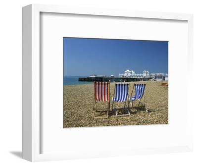 Empty Deck Chairs on the Beach and the Southsea Pier, Southsea, Hampshire, England, United Kingdom