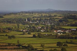 An Evening View from Crook Peak, Near Cheddar, with Glastonbury Tor in the Distance by Nigel Hicks