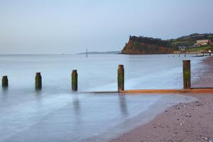 Dawn over Teignmouth Beach, with the Ness Headland in the Background by Nigel Hicks