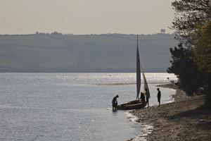 Launching a Sailing Dinghy at Mylor, on Carrick Roads, the Estuary of the River Fal, Near Falmouth by Nigel Hicks
