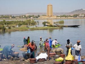 Bamako, Dyeing and Rinsing Cotton Cloth on the Bank of the Niger River Near Bamako, Mali by Nigel Pavitt